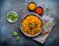 Traditional Esstern rice dish Pilaf. Pilaf - traditional Eastern/Asian dish made with rice, vegetables and meat served on vintage plate with fresh cilantro royalty free stock photography