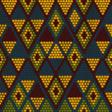 Traditional Ethnic African Ornament. Seamless vector pattern. Be. Hand drawn Ethnic background based on African ornaments. Stylized texture with triangles. Warm Royalty Free Stock Photo