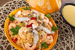 Traditional ethnic food: fish tajine. With cous cous stock photo
