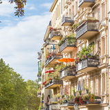 Traditional European Balcony with colorful flowers and flowerpots. Stock Photos