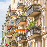 Traditional European Balcony with colorful flowers and flowerpots. Stock Image