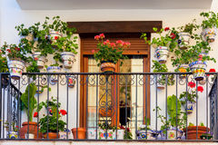 Traditional European Balcony with flowers and flowerpots Stock Images