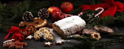 Traditional European Christmas pastry, fragrant home baked stollen, with spices and dried fruit. Sliced on rustic table with xmas royalty free stock photos