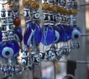 Traditional evil eye bead. Souvenir. Blurred background. To bring good luck royalty free stock photo