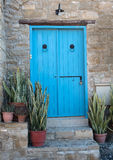 Traditional exterior house courtyard with blue wooden door and p Stock Photo