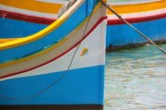 Traditional eyed boats luzzu in fishing village Marsaxlokk, Malta stock photos