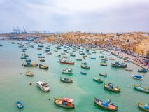 Mediterranean fishing village Marsaxlokk, Malta. Traditional eyed colorful boats Luzzu in the Harbor of Mediterranean fishing village Marsaxlokk, Malta Stock Image