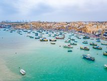 Mediterranean fishing village Marsaxlokk, Malta. Traditional eyed colorful boats Luzzu in the Harbor of Mediterranean fishing village Marsaxlokk, Malta Stock Photo