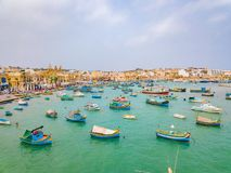 Mediterranean fishing village Marsaxlokk, Malta. Traditional eyed colorful boats Luzzu in the Harbor of Mediterranean fishing village Marsaxlokk, Malta Royalty Free Stock Photography