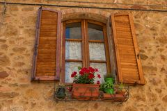 Traditional façade of Italian house in the small magical and old village of Pienza, Val D`Orcia Tuscany – Italy.  stock photos