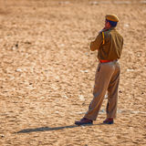 Traditional Fair in Pushkar. A police officer keeps order Royalty Free Stock Photography