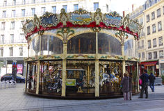 Traditional fairground carousel in Lyon, France. LYON, FRANCE - OCTOBER 10:Traditional fairground carousel in Lyon on October 10, 2013. The city is known for its Stock Image