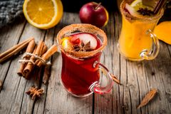 White and red hot sangria. Traditional fall and winter drinks and cocktails. White and red autumn hot spicy sangria with anise, cinnamon, apple, orange, wine. In Royalty Free Stock Photography