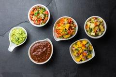 Traditional famous mexican sauces chocolate chili mole poblano, pico de gallo, avocado guacamole, salsa bandera, pinapple salsa, m royalty free stock photos