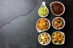 Traditional famous mexican sauces chocolate chili mole poblano, pico de gallo, avocado guacamole, salsa bandera royalty free stock photography