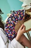 Traditional fan in woman hand Stock Photo