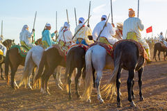 Traditional Fantasia horse riders from Morocco. Photo taken in Morocco. Fantasia is a traditional exhibition of horsemanship in the Maghreb performed during Royalty Free Stock Images