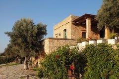 Traditional farm house with garden, Crete island, Greece. Traditional old farm house with garden, Crete island, Greece Royalty Free Stock Photos