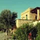 Traditional farm house with garden, Crete island, Greece. Traditional old farm house with garden, Crete island, Greece. Square toned image Royalty Free Stock Photo