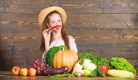 Traditional farm market. Child celebrate harvesting. Girl kid farm market with fall harvest. Kid farmer with harvest royalty free stock images