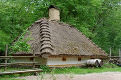 Traditional farmer's house under the thatch roof in open air museum. Kiev, Ukraine Stock Photography