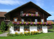 Traditional farmhouse in Bavaria. With Geranium flowers Stock Photography