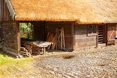 Traditional farmhouse in Sweden. Traditional old farmhouse at Skansen park, the first open-air museum and zoo, located on the island Djurgarden Stock Image