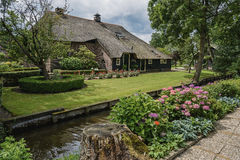 Traditional farmhouse with a thatched roof in Giethoorn, known as Dutch Venice Stock Photos