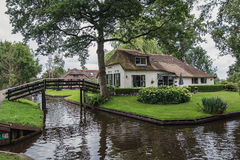 Traditional farmhouse with a thatched roof in Giethoorn, known as Dutch Venice Royalty Free Stock Images