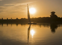 Traditional felluca sailing boat silhouette at sunset Stock Photo