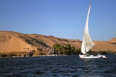 Traditional Felucca with dunes in the background Royalty Free Stock Photo