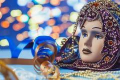 Traditional female carnival venetian mask on bokeh background. Masquerade, Venice, Mardi Gras, Brazil concept. Traditional female carnival venetian mask on blue stock photo