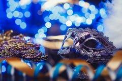 Traditional female carnival venetian mask on bokeh background. Masquerade, Venice, Mardi Gras, Brazil concept. Traditional female carnival venetian mask on blue royalty free stock image