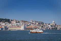 A traditional ferry boat Cacilheiro crossing the Tagus River in Lisbon. A traditional ferry boat Cacilheiro crossing the Tagus River with the Lisbon skyline on stock image