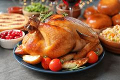 Traditional festive dinner with delicious roasted turkey served on table stock photography