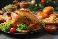 Traditional festive dinner with delicious roasted turkey. Served on table stock photos