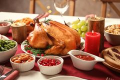 Traditional festive dinner with delicious roasted turkey. Served on table stock image