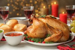 Traditional festive dinner with delicious roasted turkey. Served on table stock photo