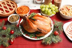 Traditional festive dinner with delicious roasted turkey. Served on table royalty free stock images