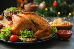 Traditional festive dinner with delicious roasted turkey. Served on table royalty free stock image