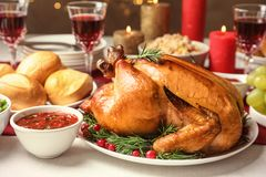 Traditional festive dinner with delicious roasted turkey served. On table stock photo
