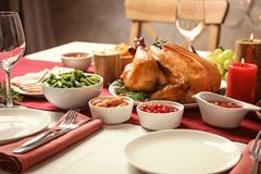 Traditional festive dinner with delicious roasted turkey served. On table stock photos