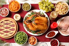 Traditional festive dinner with delicious roasted turkey served on table. Flat lay royalty free stock images