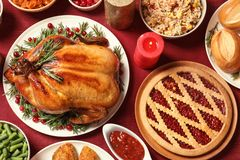 Traditional festive dinner with delicious roasted turkey served on table. Flat lay stock photography