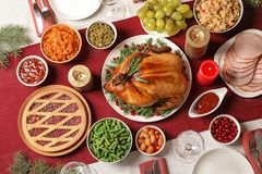 Traditional festive dinner with delicious roasted turkey served on table. Flat lay royalty free stock image