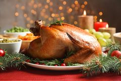 Traditional festive dinner with delicious roasted turkey served. On table stock photography