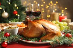 Traditional festive dinner with delicious roasted turkey. Served on table stock photography