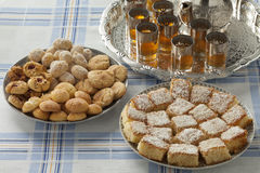 Traditional festive Moroccan cookies and tea Royalty Free Stock Photos