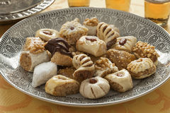 Traditional festive Moroccan cookies and tea Stock Photos