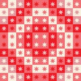 Festive seamless repeat pattern of geometric squares and stars. A Christmas vector design in red and cream. royalty free illustration